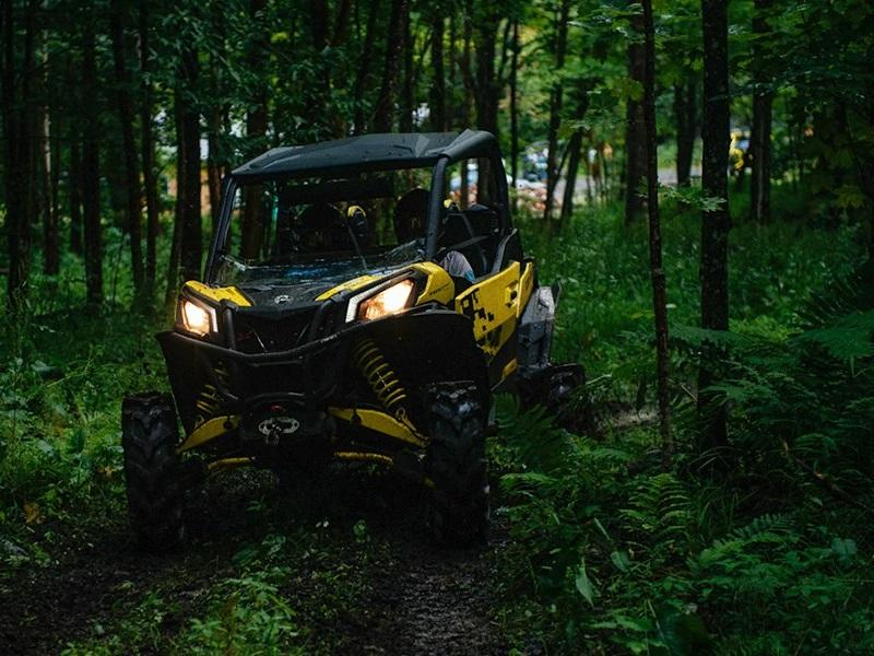 2019 Can-Am® Maverick™ Sport X mr 1000R driving through forest trail