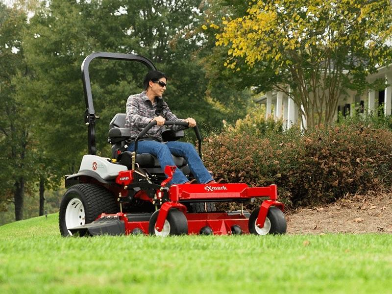 Lady mowing a large lawn with a 2019 Exmark Lazer Z X-series riding mower