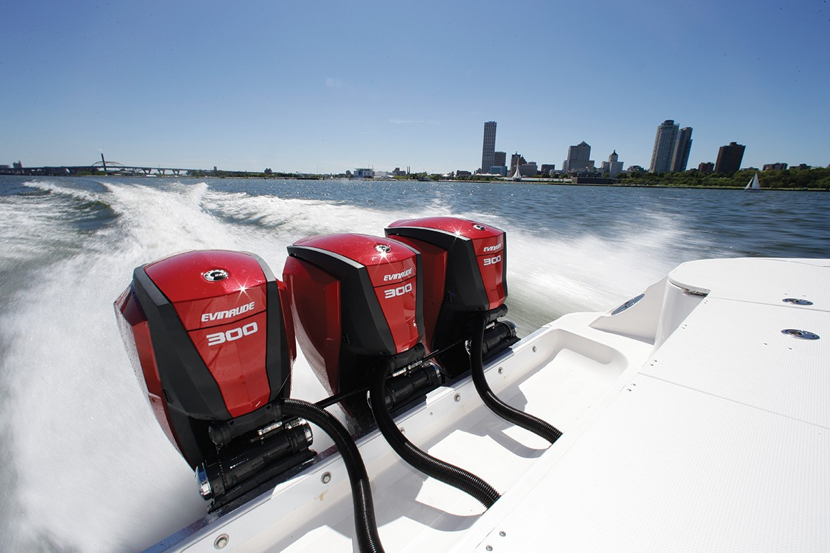 Shot of three Evinrude engines moving a boat real fast