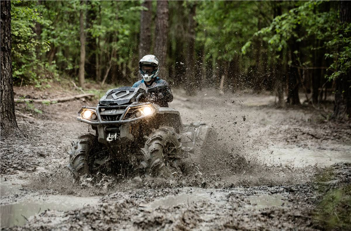 Can-Am Outlander taking on a big stretch of mudholes.