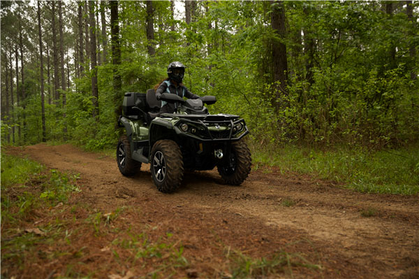 Can-Am Outlander on a trail through the woods.