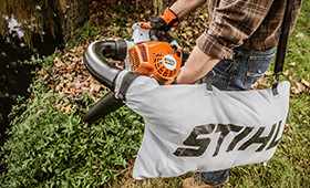 STIHL lawn vacuum sucking up leaves