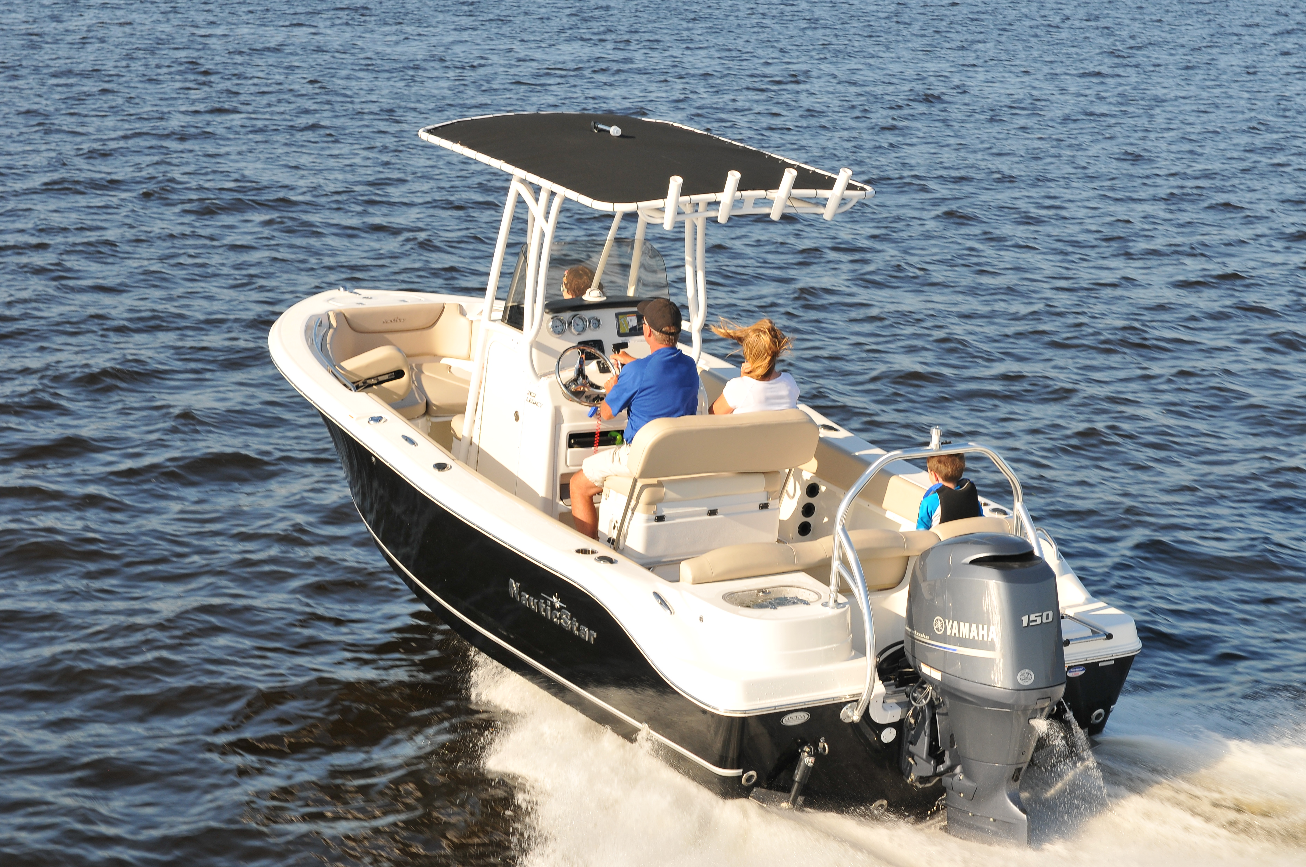 Family of four cruising in a NauticStar boat with a Yamaha outboard.