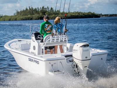 A couple cruises the water on a Sea Pro 208 bay boat.