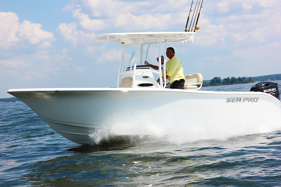 Two men cruise the water on a Sea Pro deep-V center console boat.