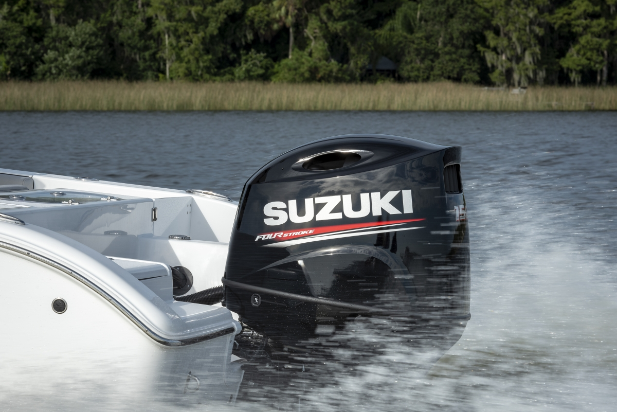 Powerful Suzuki DF150A outboard motor on the back of a speeding boat.