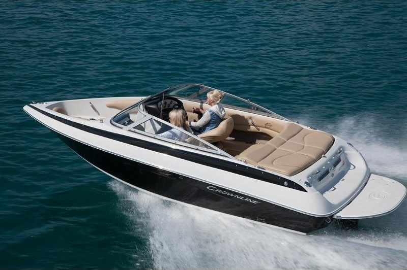 2019 Crownline 18 SS cruising on a body of saphine blue water on a sunny day