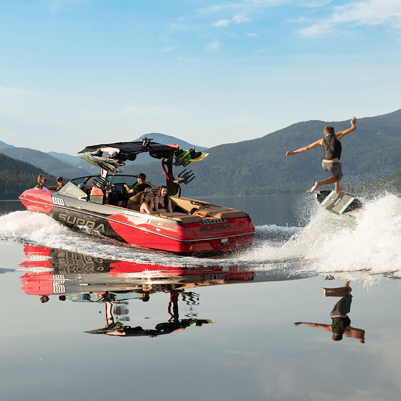 Wakesurfer on the wake of a 2019 Supra® SE boat