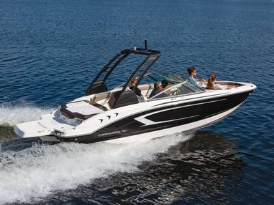 A family speeds over the water on a Chaparral 21 H20 Sport Bowrider boat.