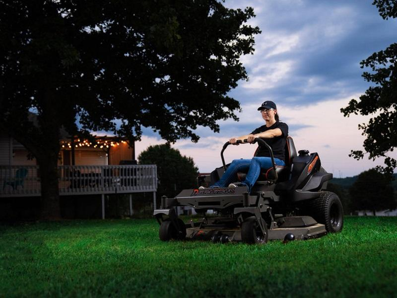 Lady riding a 2019 Spartan Mowers RZ HD in a backyard