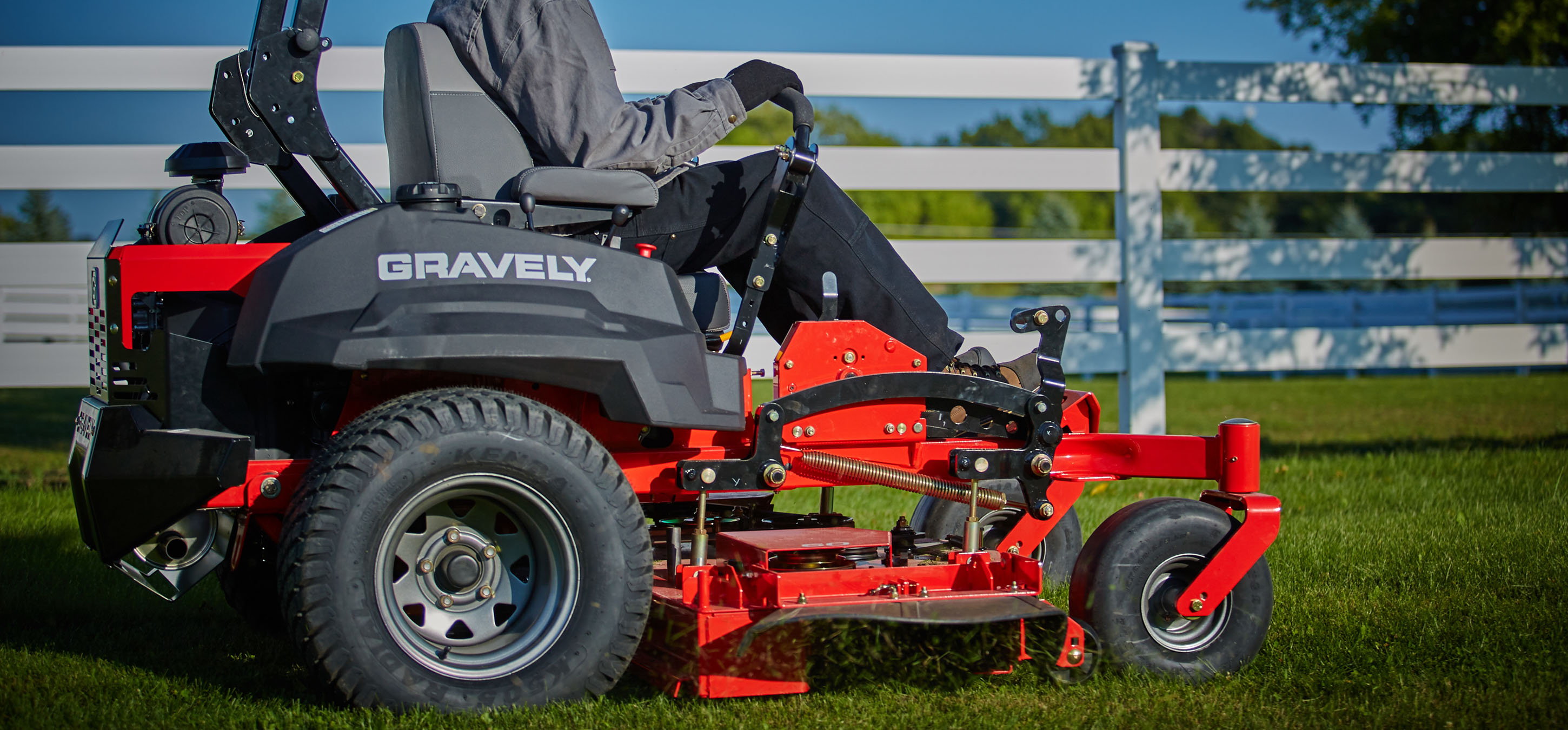 Gravely zero-turn lawn mower in use