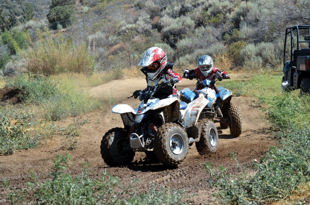 Youth ATV being used on the dirt.