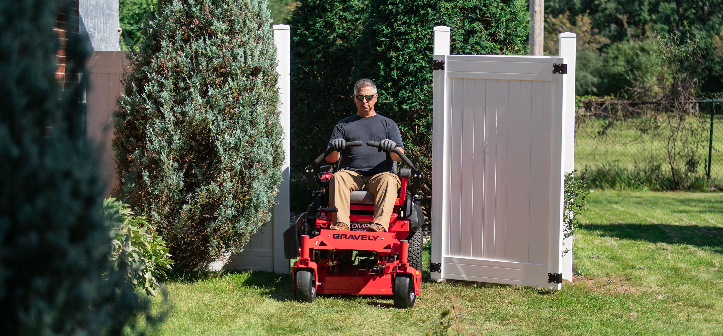 Gravely Compact Pro Mower in Fence Door near Lancaster, NH