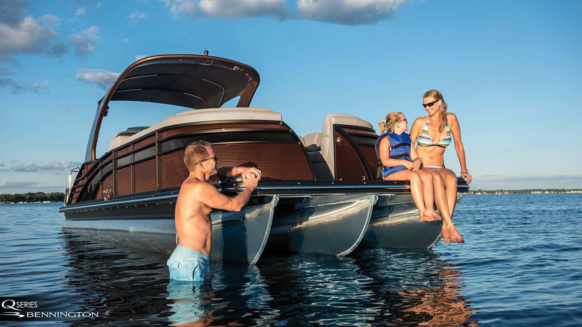 Family enjoying the sun out on a Bennington pontoon boat.