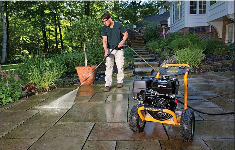 Man using Cub Cadet pressure washer