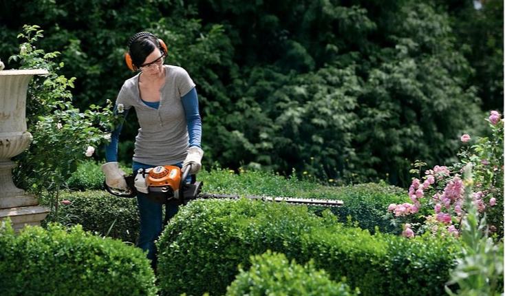 Woman using STIHL brush cutters