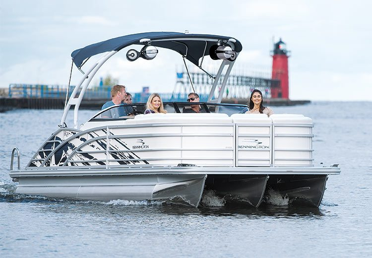 Group of people enjoying some time on a Bennington Pontoon boat