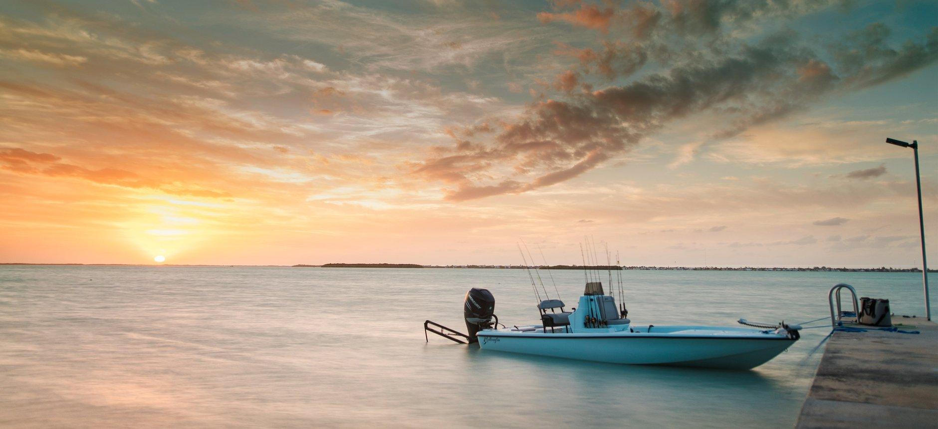 Merury Marine outboard docked at sunset