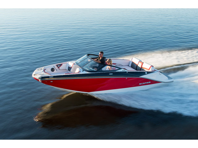 Scarab jet boat cruising across glassy water