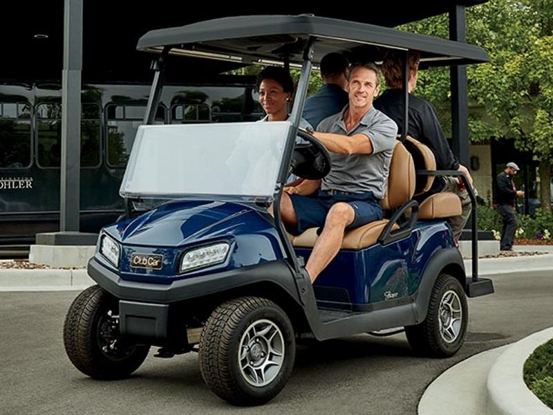 Group of people using a Club Car® golf cart to cruise around
