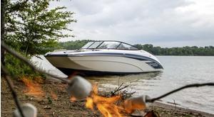 Yamaha SX240 docked near campfire