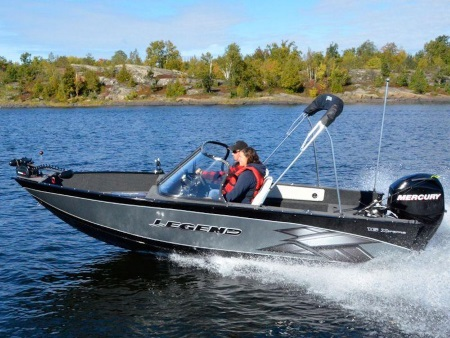 A couple on a 2013 Legend Boat Xtreme Series 16 Xtreme