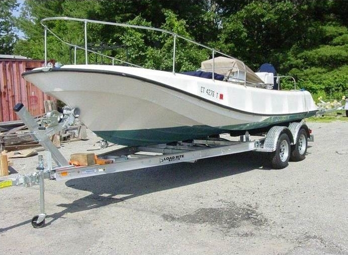 Boat on a double axle Load Rite trailer