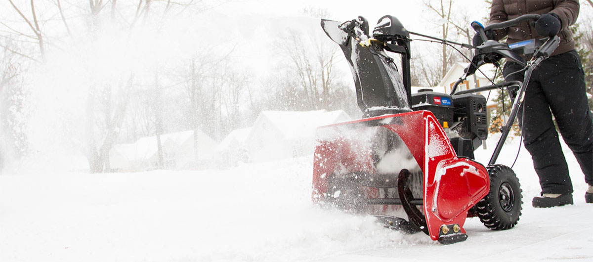 Toro snowthrower clearing the sidewalk of snow