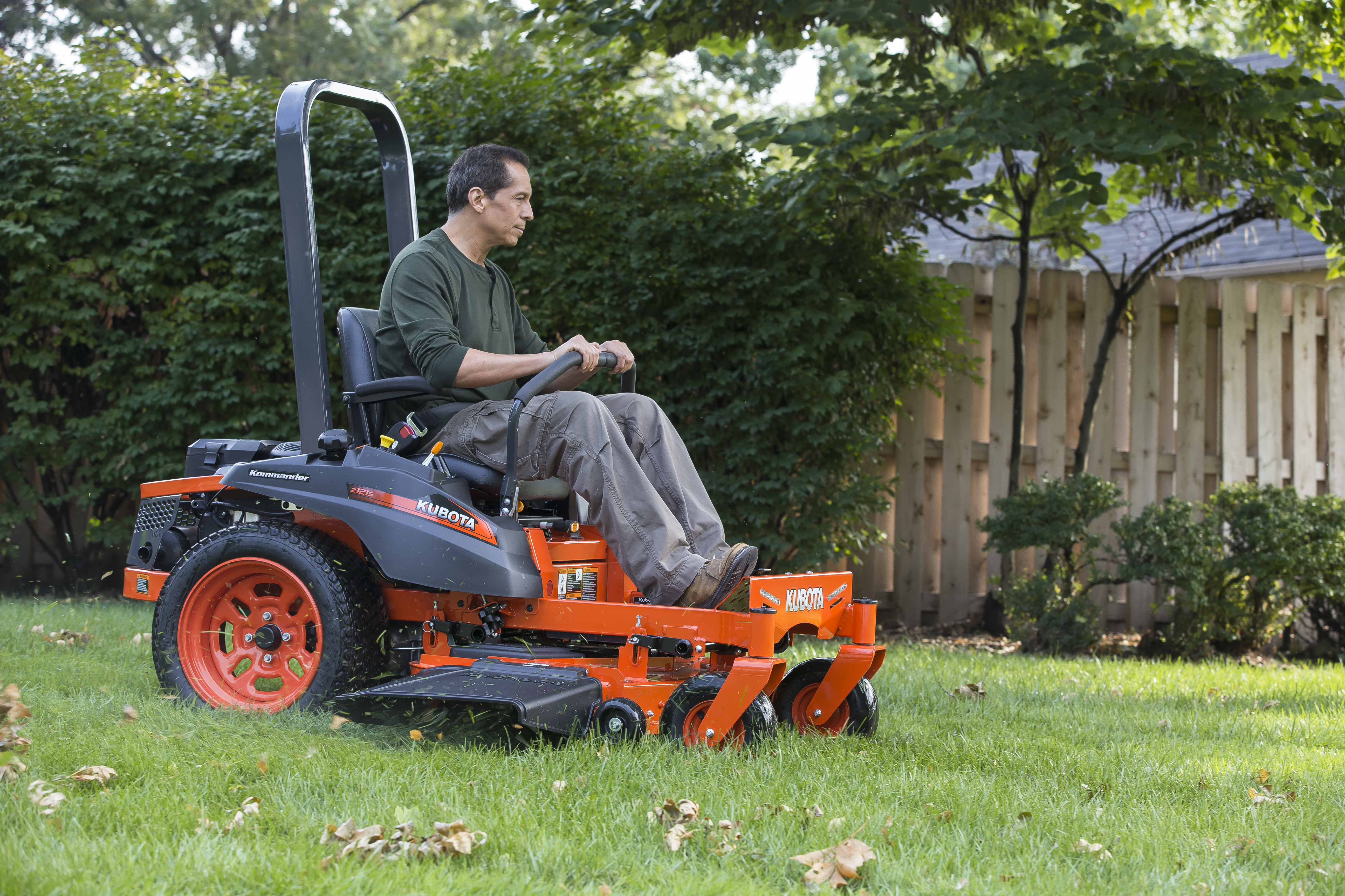 Man mowing lawn on a Kubota Zero Turn Mower
