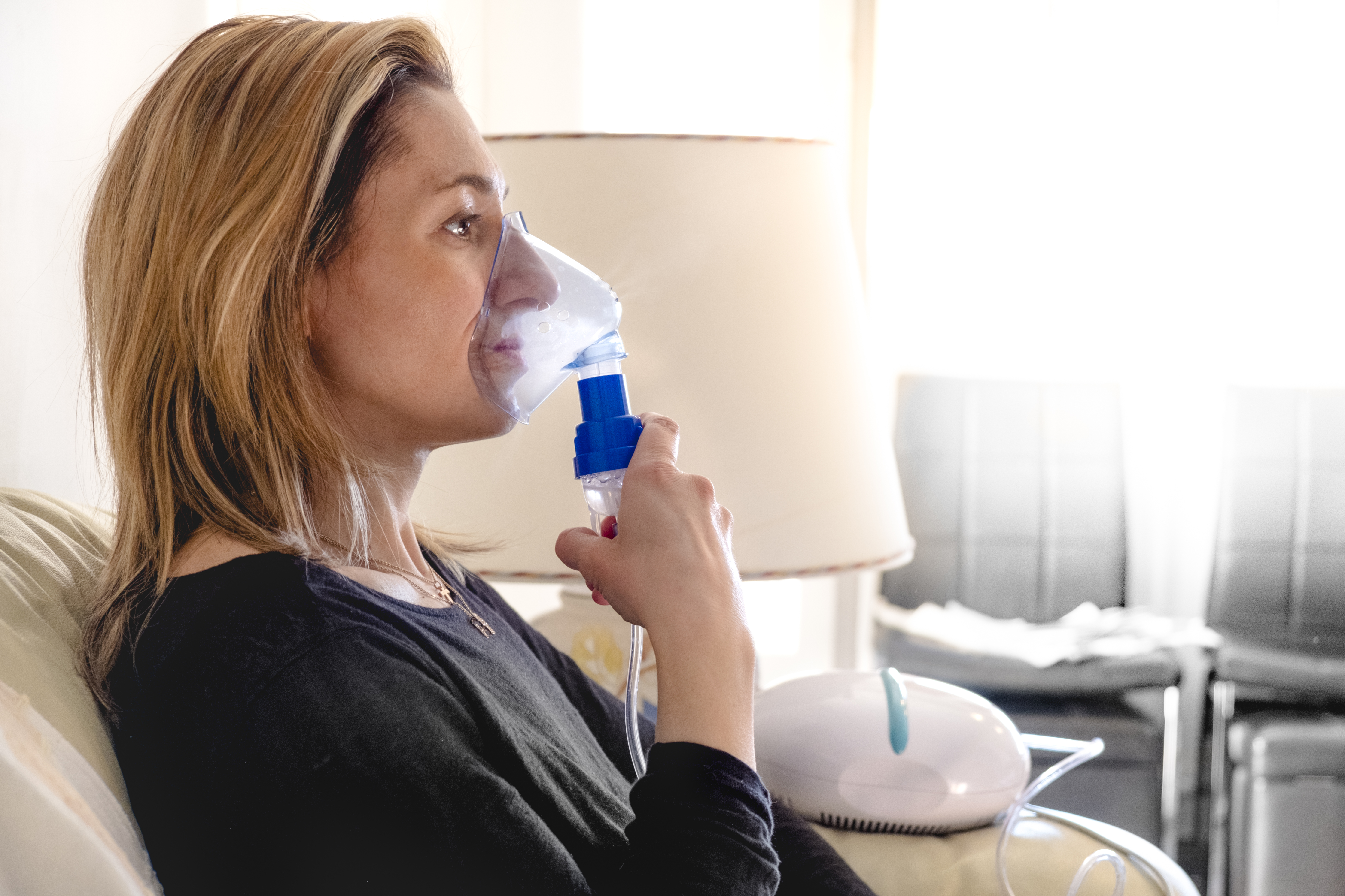 Woman Using A Nebulizer