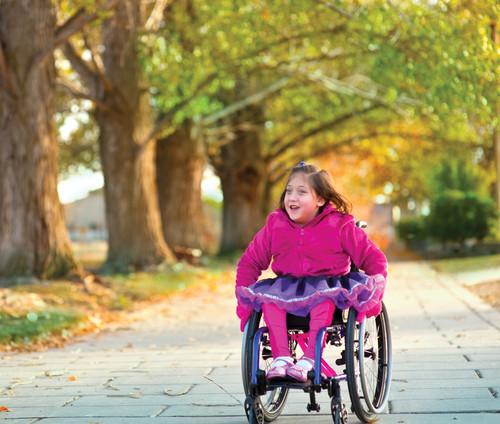 Youth Enjoying Freedom in Manual Wheelchair