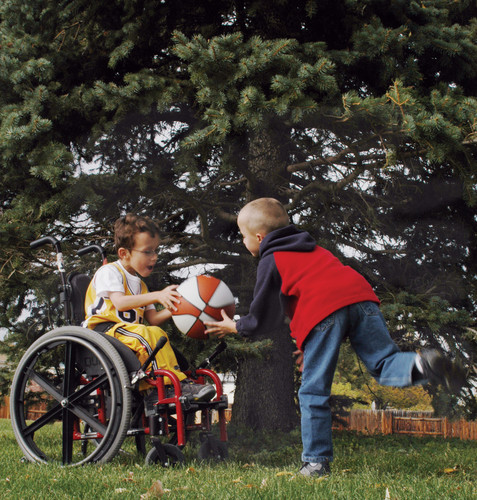 Youth Playing Basketball in Manual Wheelchair