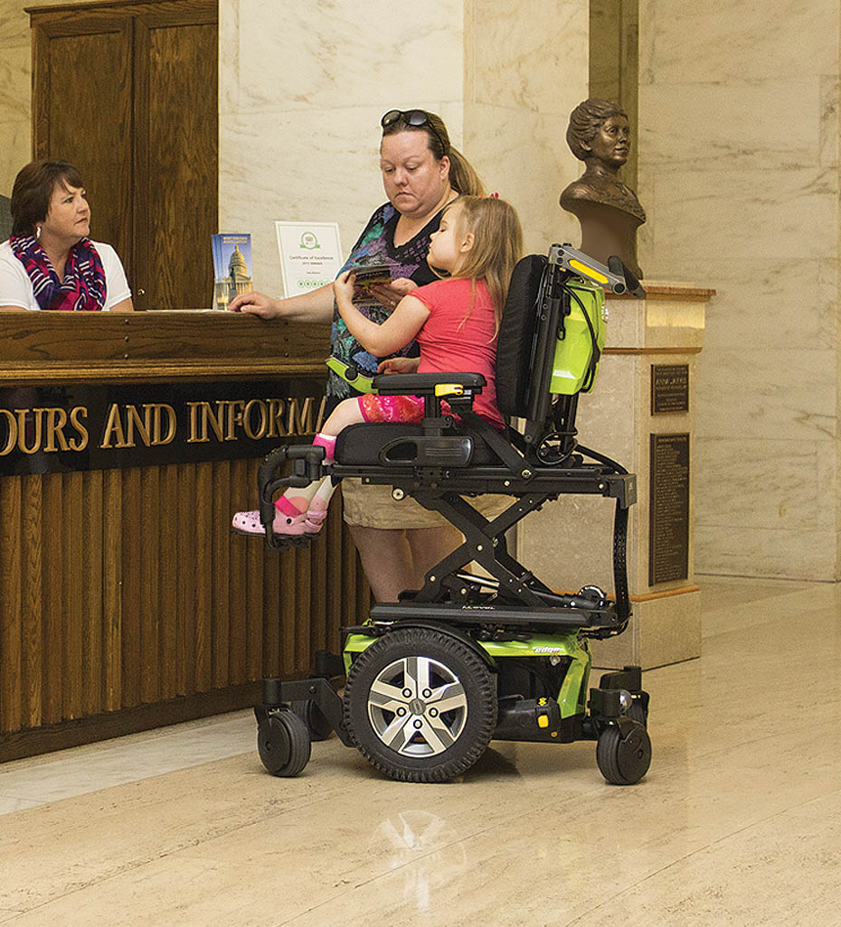 Youth at Front Desk in Power Wheelchair