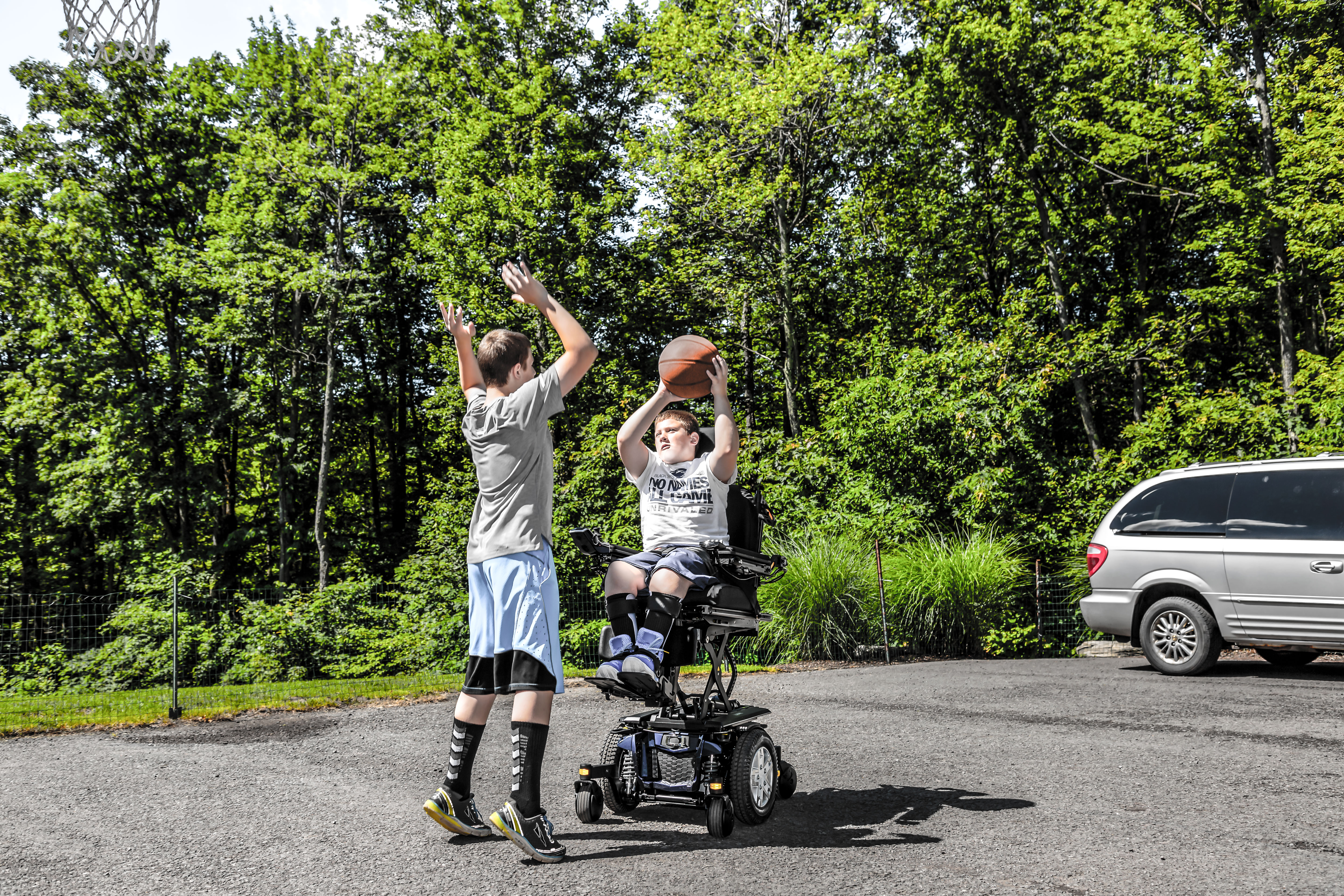 Youth Playing Basketball in Power Wheelchair