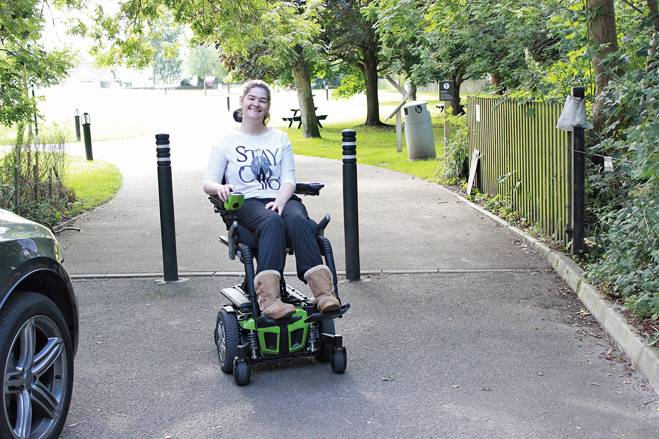 Young Woman in Power Wheelchair at the Park