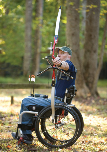 Man Doing Archery from Manual Wheelchair