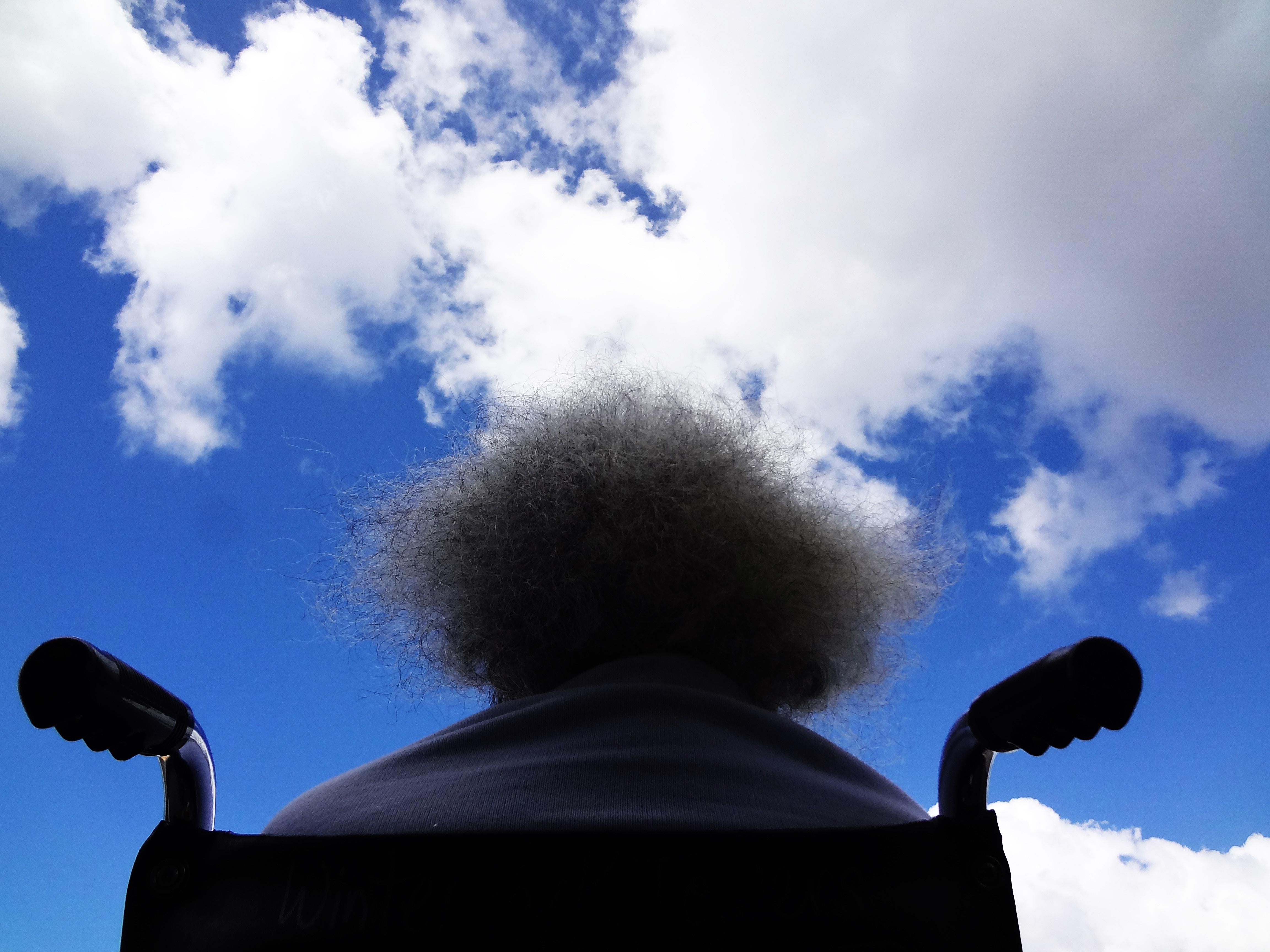 Man in wheelchair looking at sky