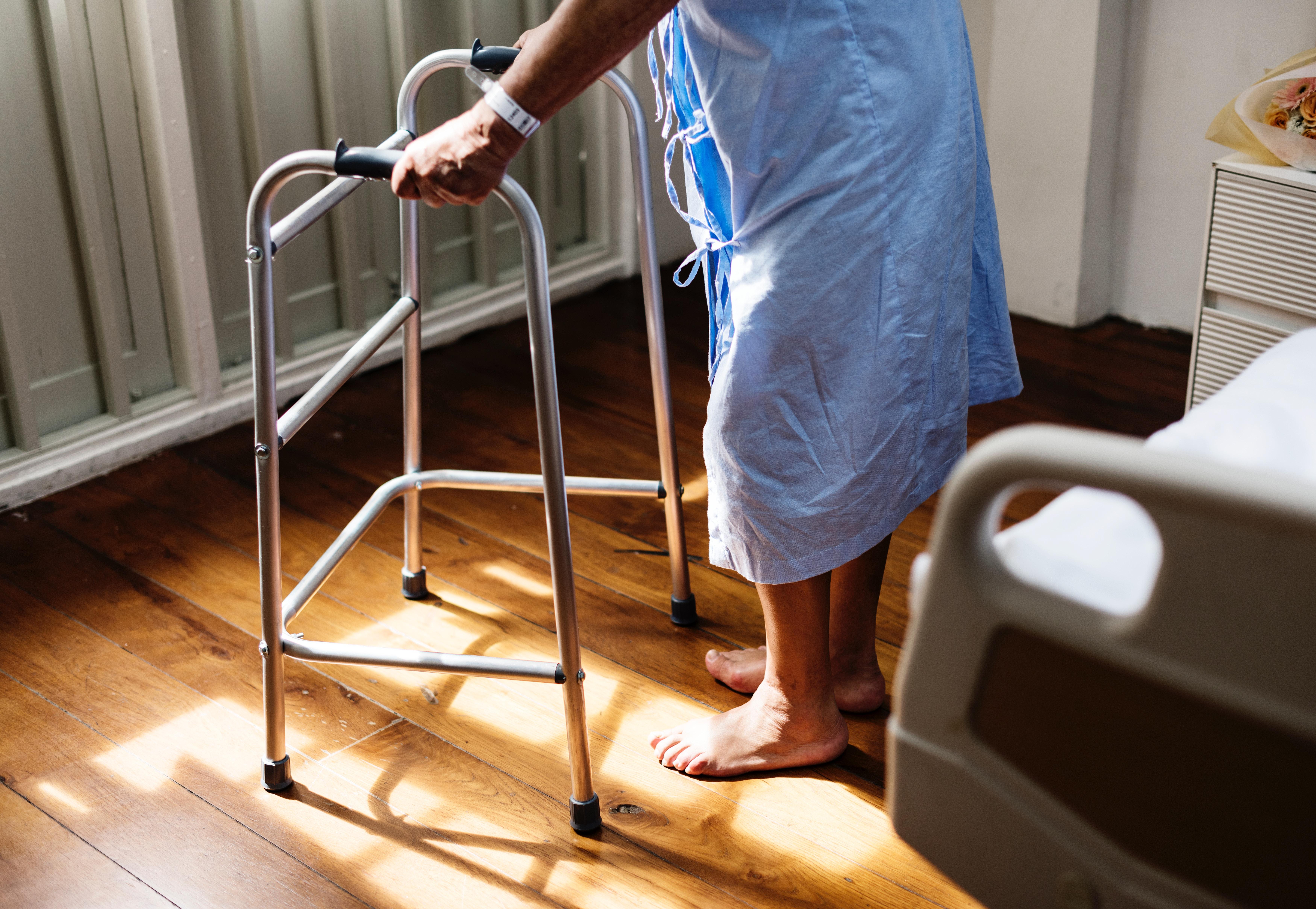 man using walker in hospital