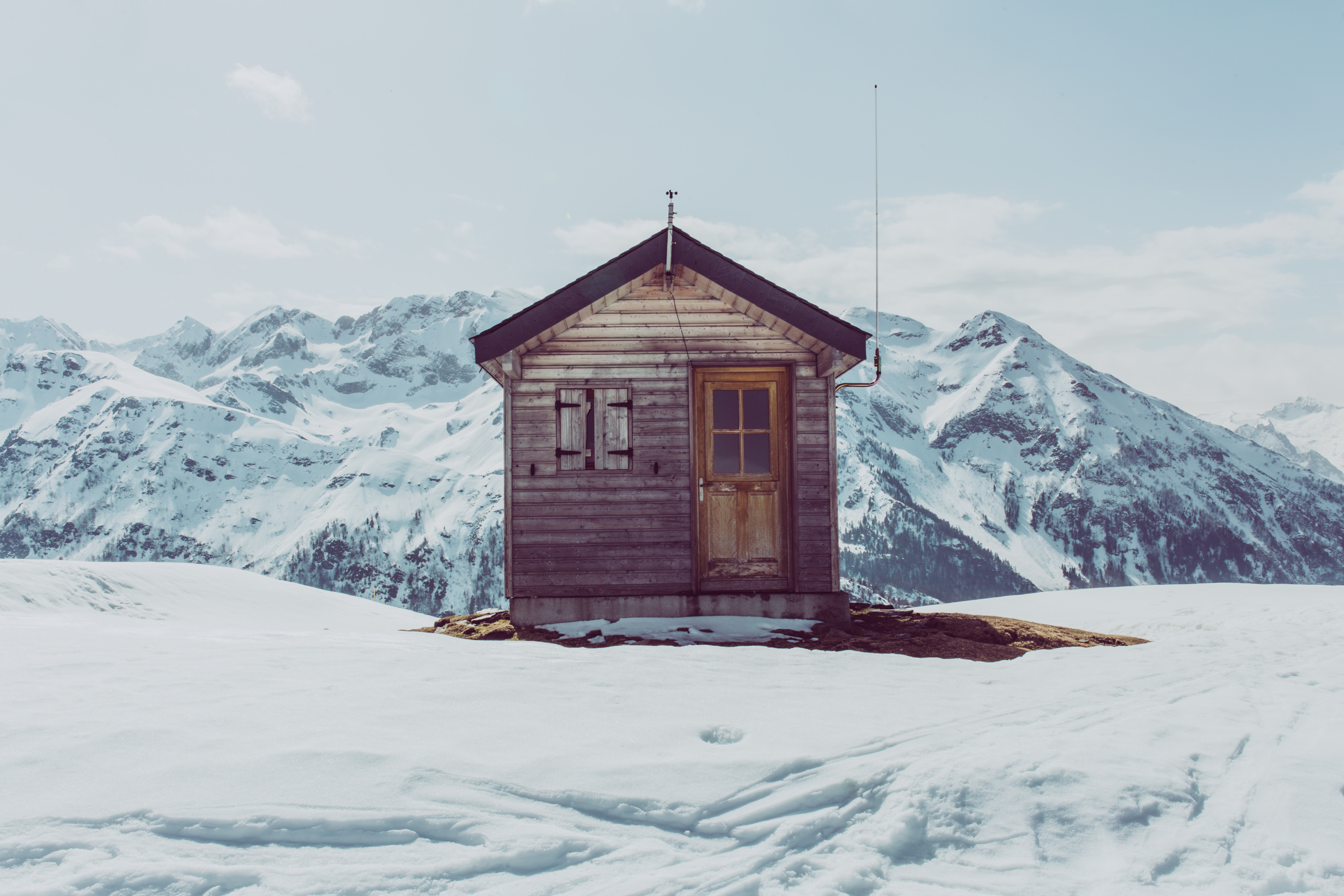 Snow Surrounding Home in Mountains