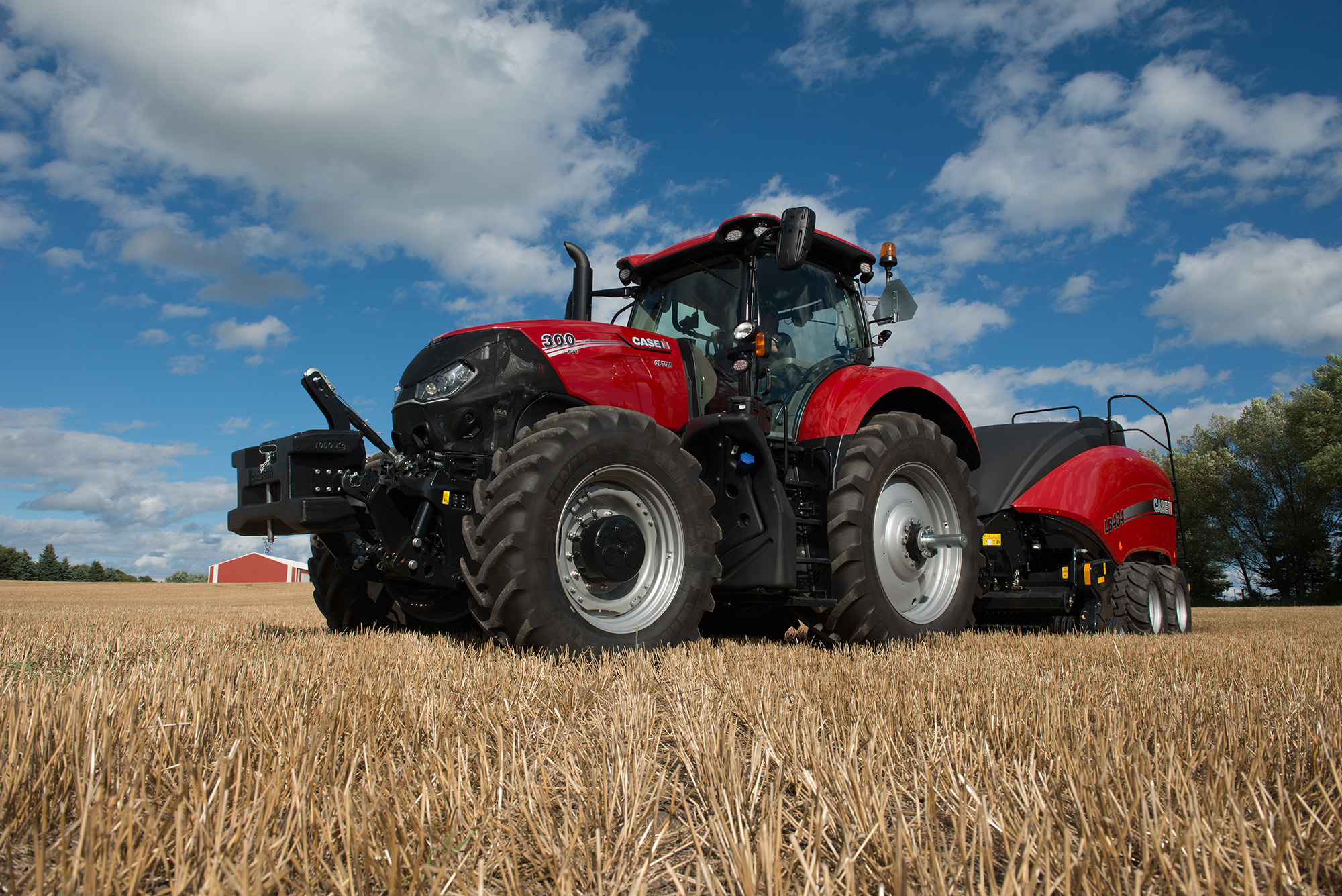 Side view of a Case IH tractor sitting idle in a  field.