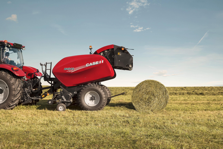 Case IH bailer bailing hay into rolls.