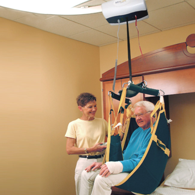 RehabEquipmentProfessionals-Ceiling Lift hoisting a man from bed