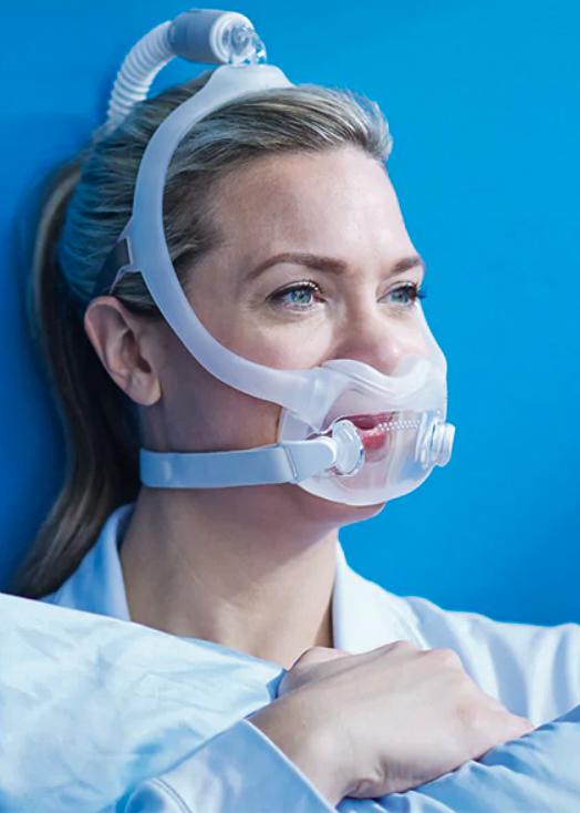 Woman wear respironics CPAP mask