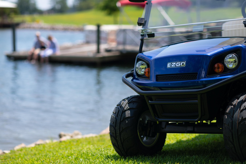 E-Z-GO golf cart parked next to a lake